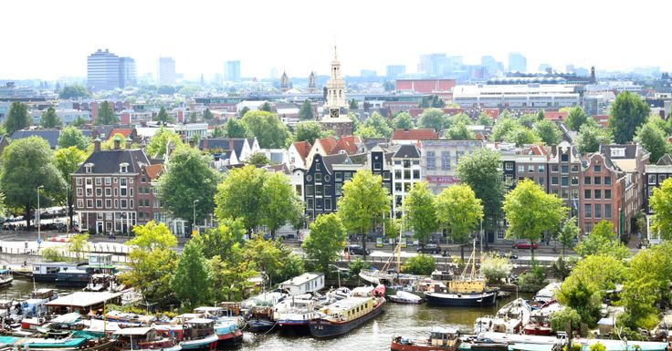 Amsterdam canal, bike friendly city. Beauitful boats and houses. View from top. Amazing city