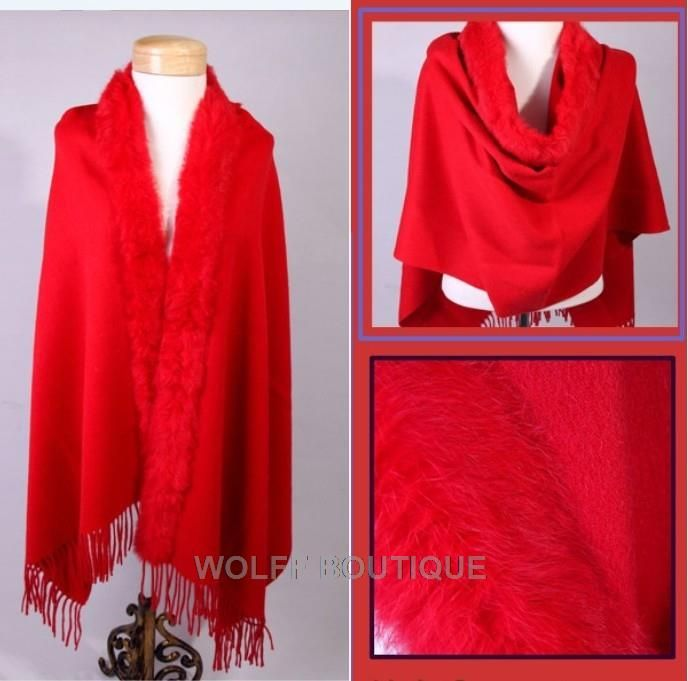 A deeper blue based red than the picture shows.  Edged in rabbit fur and tassels along the other.  Keep the wind and chills at bay in this cashmere stole/shawl.  A much needed accessory year round. Contact:  wolffboutiquefashion@gmail.com