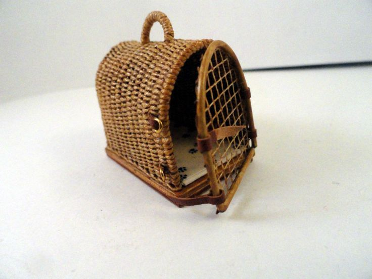 """HAND WOVEN DOG CARRIER WITH ADORABLE HINGED DOOR.. ARCH TOP, WOVEN HANDLE.. BUCKLES AS LATCHES..  LINED WITH DOG PAW PRINT. WOOD BASE... PERFECTLY MADE~~ 1 1/4"""" tall 1 1/2"""" deep.. 1"""" wide"""