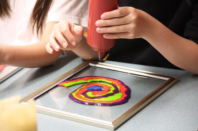 I was inspired by the glue frames featured over at Play At Home Mom and thought the kids would like to try it. I bought four condiment bo...