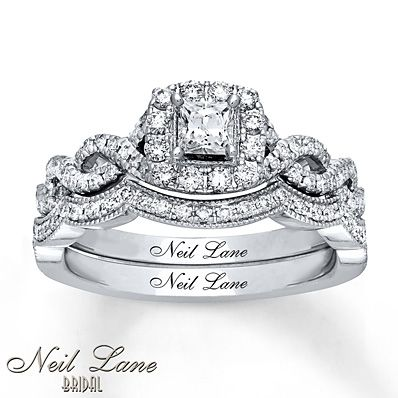 This stunning bridal set from the Neil Lane Bridal® collection features a sparkling round diamond within a halo of round diamonds. Additional round diamonds line the ring and the matching wedding band, bringing the total diamond weight to 3/4 carat. The bridal set is fashioned in 14K white gold. Each Neil Lane Bridal® diamond ring is hand-crafted and undergoes a four-step polishing process, which gives the ring its beautiful shine and luster. Each ring has Neil Lane's signature ins...