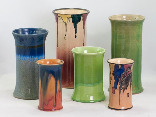 PPP early series 003 cylinder shaped vases some with art deco design and others with drip glaze pattern.