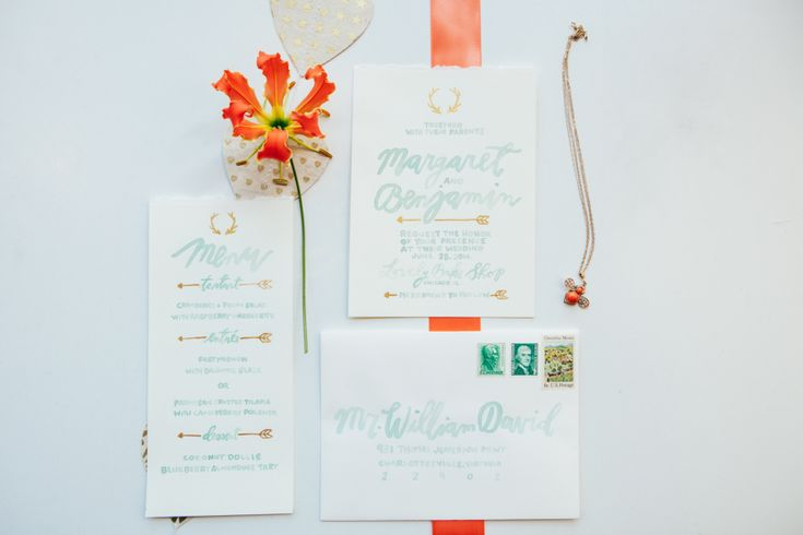 {{White and pale blue wedding invitations with arrows and gloriosa lillies for spring wedding editorial at Lovely Kitchen and Cafe in Chicago, featured in Style Me Pretty.}} Photography and concept by Studio Finch http://studiofinch.com/    Flowers by Pollen, pollenfloraldesign.com