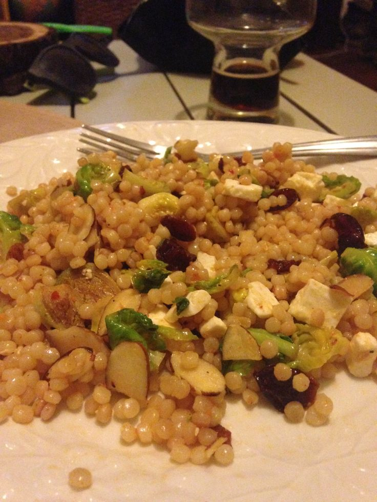 Israeli couscous with brussel sprouts, shallot, sliced almonds, dried cranberries, feta, and a sauce made with olive oil, chili garlic paste and lemon. Credit: Evan Patrick (bf)