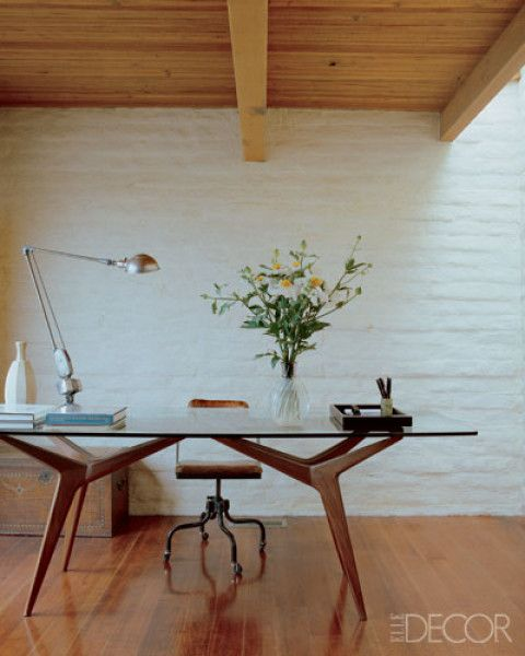 California, interior designer Michael S. Smith uses a vintage Gio Ponti glass-top table as his desk.