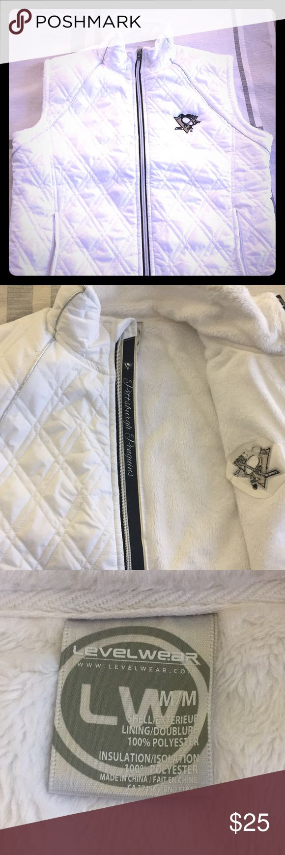 Pittsburgh Penguins Vest Winter white vest with Pittsburgh Penguins Logo and silver details. Lining is soft and warm, great to wear to a game! Worn a few times but in perfect condition! Inside detail along zipper. Pockets zip close. Jackets & Coats Vests