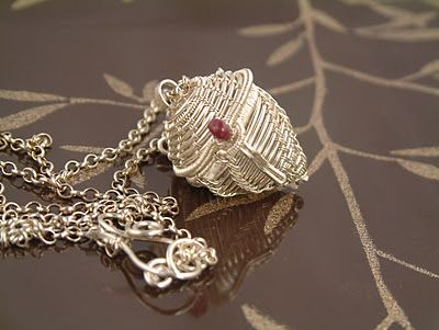 I made this by weaving fine silver wire. The bead is a Ruby. It has hinges and a clasp. http://fleurviolettejewelry.blogspot.com/2012/01/yoj-2012-week-4-fine-silver-woven.html