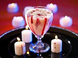Vampire Halloween Cocktail | This dessert-worthy combination of vanilla ice cream, triple sec and white crème de cacao is deliciously disgusting, thanks to drizzles of blood-red grenadine down the sides of the glass. |   By : American Professional Bartending Schools of Illinois in Chicago | From: hgtv.com