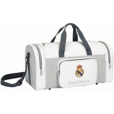 Bolsa de deportes Real Madrid  Bolsa de deportes grande del club de Chamartín  Amplio compartimento central y bolsillos con cremallera en ambos extremos  Correa regulable en altura y desmontable  Dimensiones: 55 x 26 x 27 cm  Producto oficial Real Madrid  Fabricado por Safta