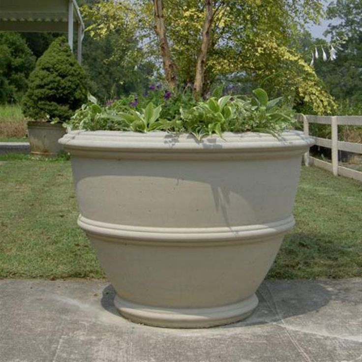 Round Fiber Reinforced Concrete Angelica Outdoor Planter - Made from durable fiber-reinforced concrete, the Angelica Planter is an easy planting solution with clean lines for a classic look. This round planter...