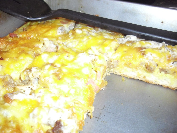 Breakfast pizza-bisquick, cooked sausage, bacon, ham, sausage gravy, cheese, and eggs. baked 400F 20-25 minutes