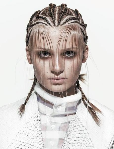 We love the idea of creating dual texture using intricate braids with our model's natural hair type and using product to make wet-look designs on face - possibly kiss curls?