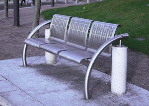 The seats on this bench have been formed (and punched). The side bars are extrusions which have been rolled in curves.