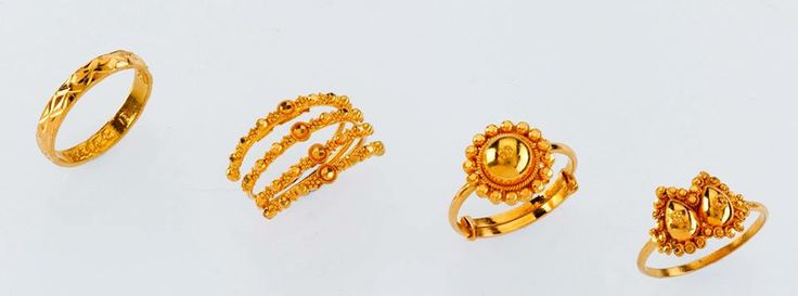 """""""Attractive Rings - only from the gold factory""""  Left to right   a) 2.050 gm, Rs 6,700/- b) 4.050 gm, Rs 12,930/- c) 3.100 gm, Rs 9,900/- d) 3.550 gm, Rs 11,330/-"""