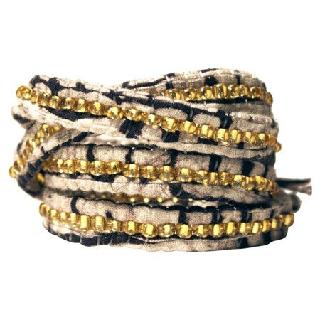 Beaded batik fabric wrap bracelet crafted by artisans in Rwanda.
