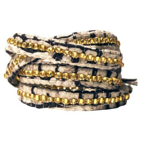Beaded batik fabric wrap bracelet crafted by artisans in Rwanda.