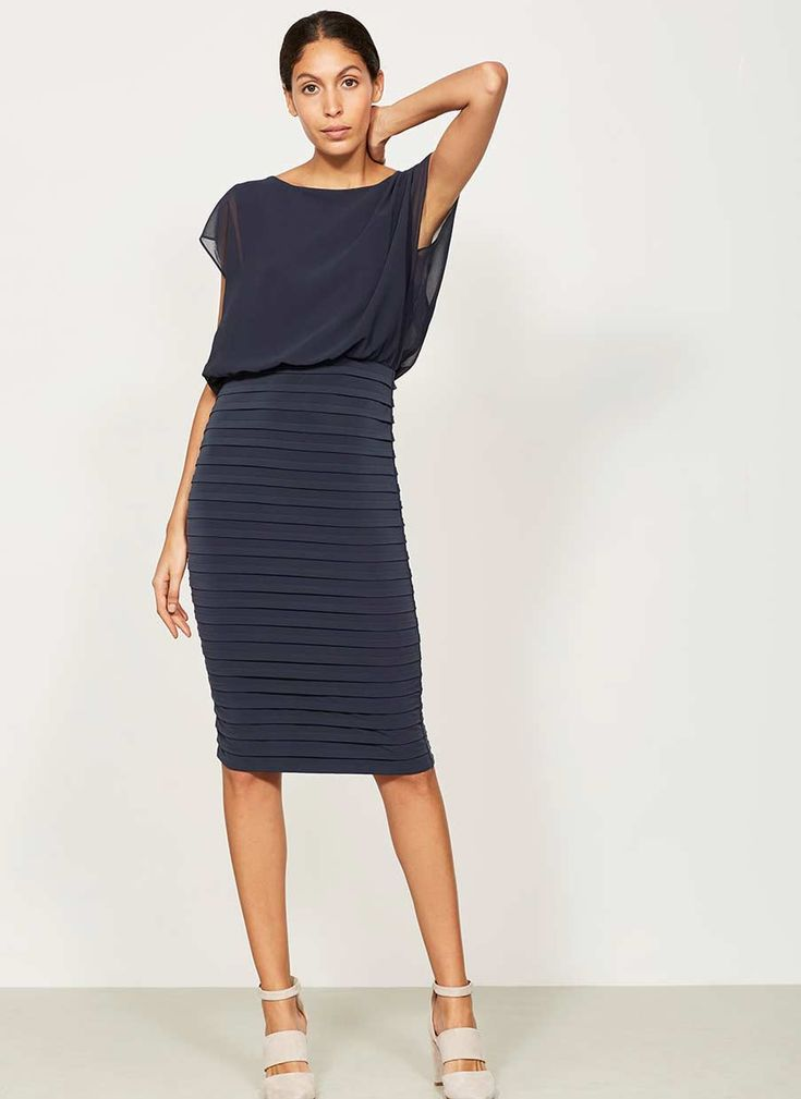 Introducing our new MINT collection of everyday luxury pieces. Web Exclusive Flattering sexy ink bandage pencil dress with a contrasting woven top layer with back cape detail and a sexy V-back. Model is 5'10in and wears a UK size 10.The length from side neck point to front hem measures 104cm/41in.