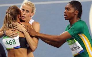 Caster Semenya (R) of South Africa reacts next to Melissa Bishop (L) of Canada and Lynsey Sharp (C) of Britain after winning the women's 800m final of the Rio 2016 Olympic Games Athletics, Track and Field events at the Olympic Stadium in Rio de Janeiro, Brazil, 20 August 2016.