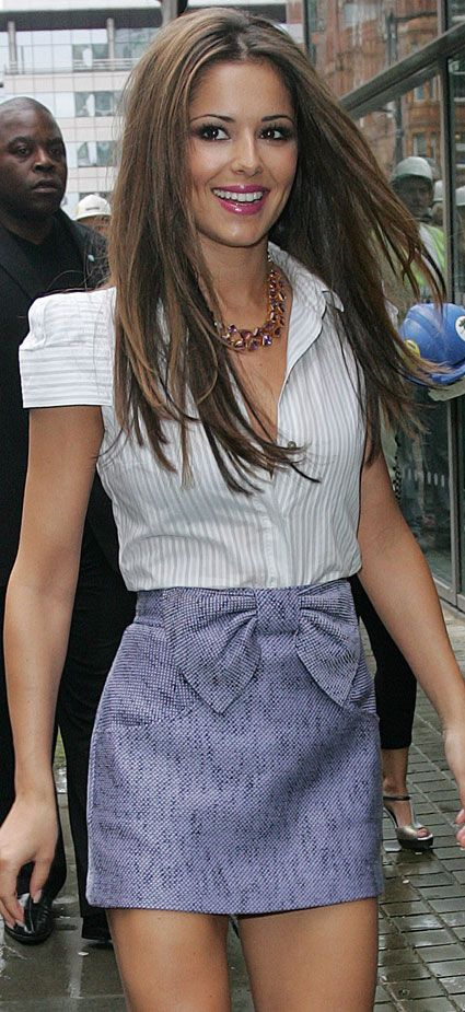Cheryl Cole wearing a delightful little bow skirt. Cute!