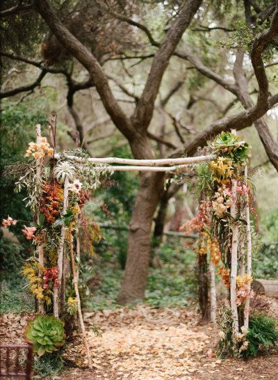 a ceremony backdrop with a forest vibe