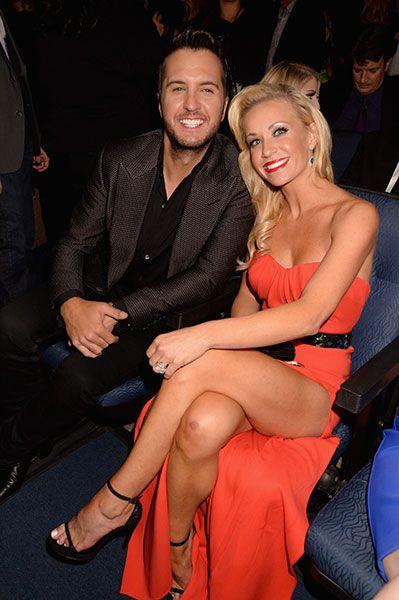 Luke Bryan and Caroline Boyer attend the American Music Awards on Nov. 23, 2014, in Los Angeles.