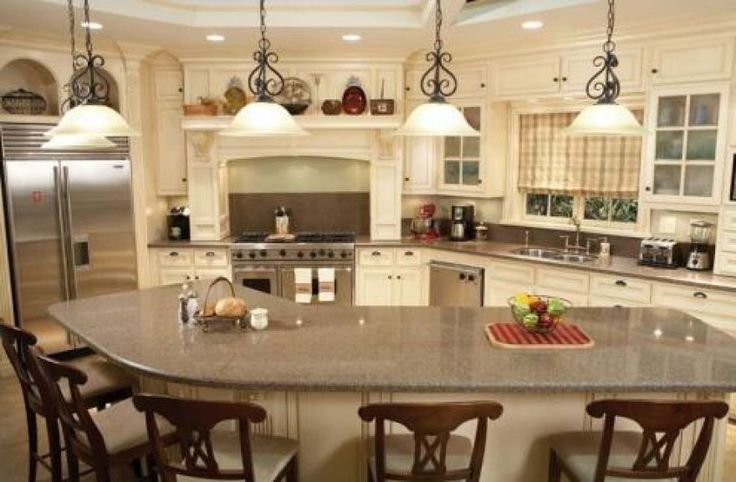 Curved l shaped breakfast bar interior design for unique for Different shaped kitchen island designs with seating