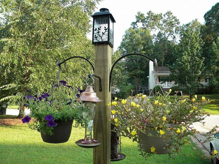 The birds and the bees will flock to this DIY freestanding bird feeder/flower post.
