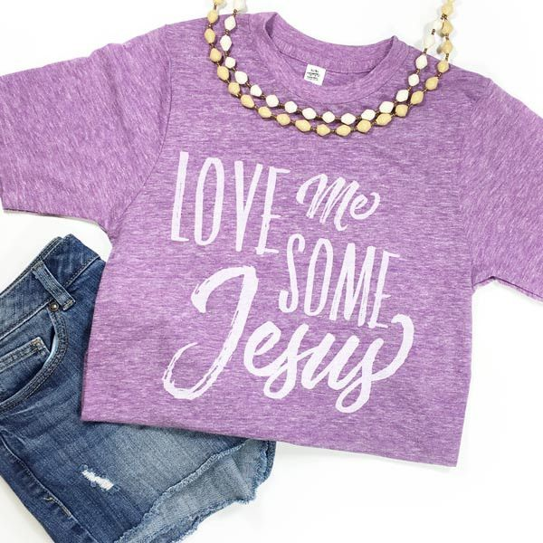 """This is a super-soft unisex tee with our """"Love Me Some Jesus"""" design. Looking for the Toddler Version? Fit: Unisex and runs true to size. *Tri-Purple with Vintage white design. Size Bust/Chest Inches"""