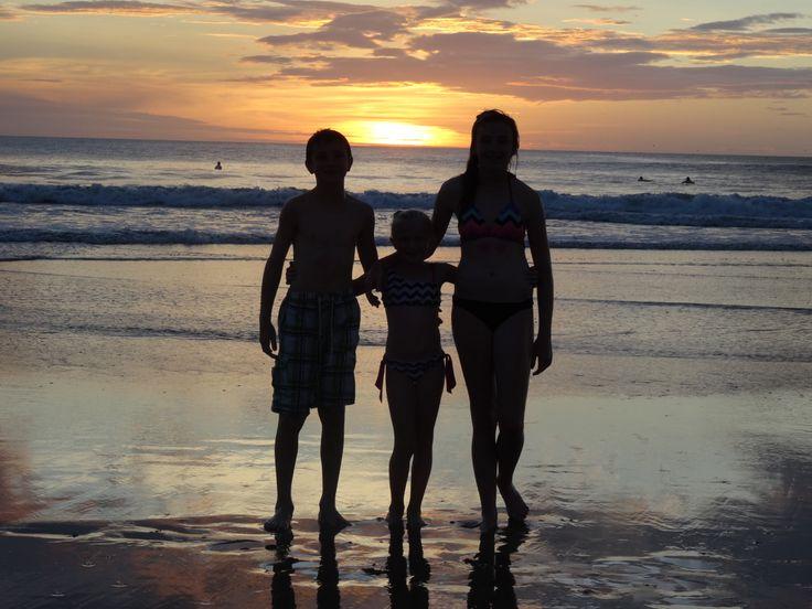 On the beach at sunset in Tamarindo, Costa Rica.