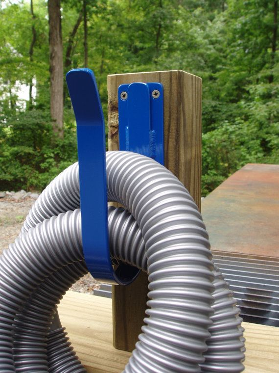 25 best ideas about hose hanger on pinterest garden for Garden hose solutions