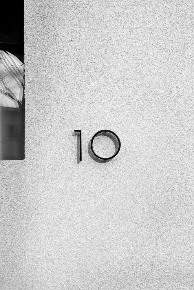 Modernist door number made of steel