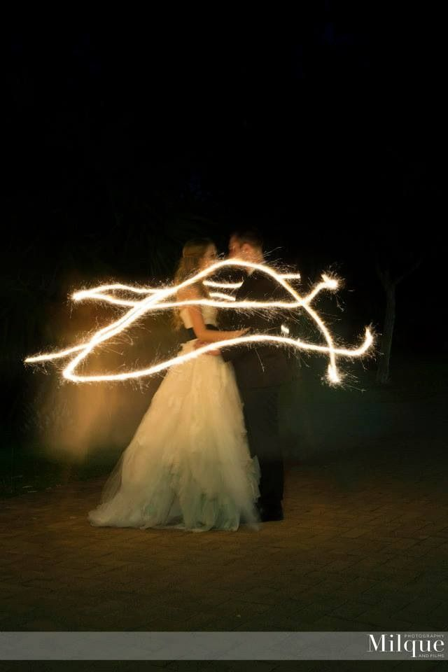 The firefly effect... Have your photographer do this for your wedding. Bride and groom stand together and someone (for us it was a dedicated bridesmaid) runs in circles around them with a sparkler. It creates this stunning romantic firefly effect!