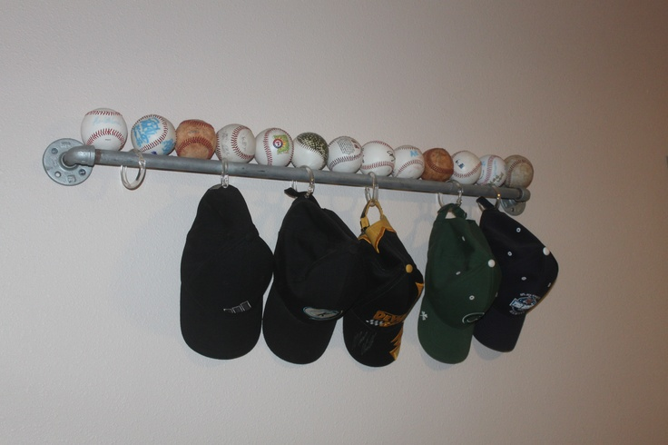 This is great to display those special baseballs that are caught at the game! Also by using shower rings you can hang baseball hats at the same time!