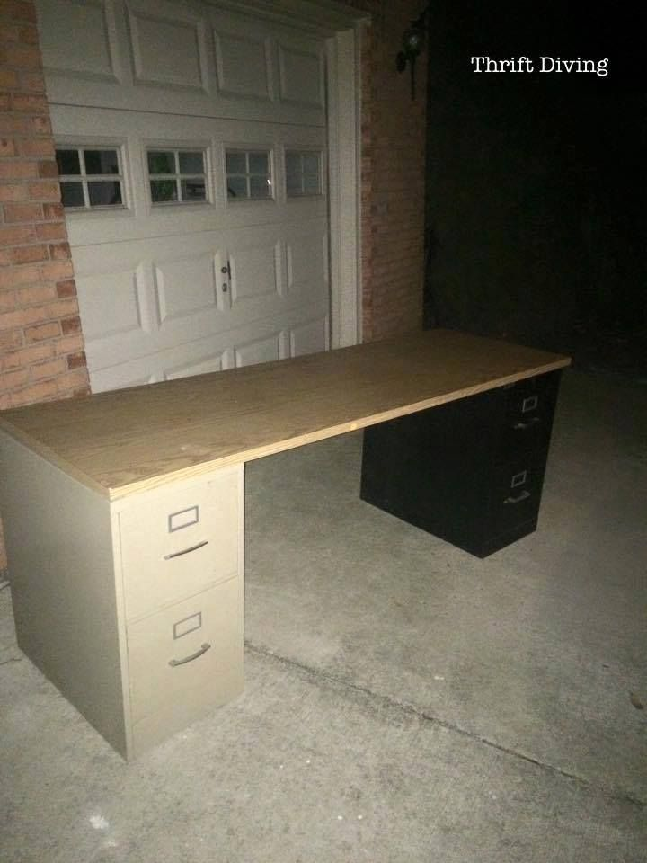 """Make a desk out of thrifted file cabinets with a scrap piece of counter top on top! See the """"AFTER."""""""
