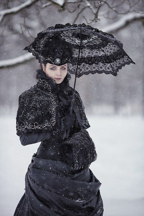 A black lace parasol is the perfect gothic fashion accessory. This woman looks very Russian to me. Like she's straight out of Dr. Zhivago. Beautiful.