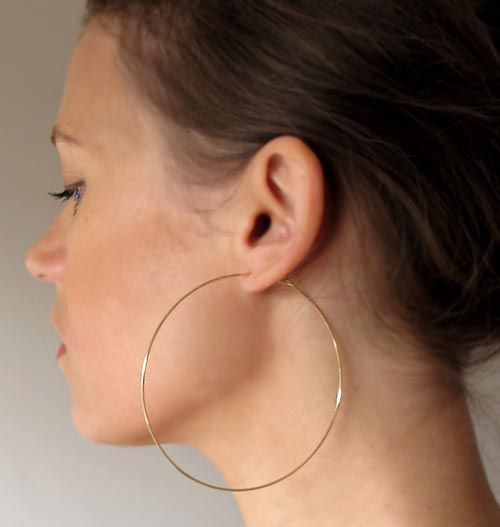 Big thin gold hoop earrings. And they absolutely don't have to be real gold. I think you can get ones like this at claires.