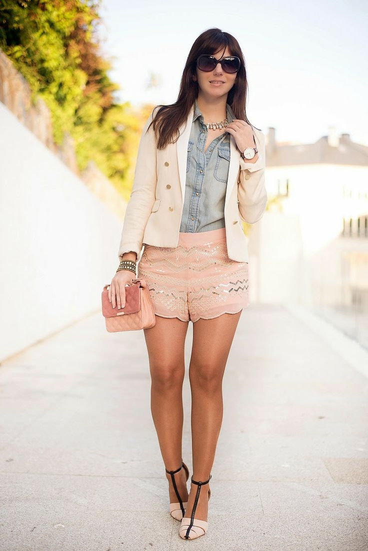 Lace shorts, jean shirt, and blazer. A lot going on but very well put together. Summer fashion.