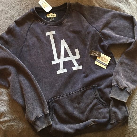 LA Dodgers pigpen crew sweatshirt Red jacket BNWT lightweight crew neck fleece with raglin shoulders and kangaroo pocket. Reverse vintage washed for a super-soft hand-feel, with ribbed knit cuffs, neck and closed bottom hem. Water-based one color screen-print center chest. Trim, athletic fit. Bought from the official Dodgers store at the stadium. Never worn. Super comfy! Red jacket Tops Sweatshirts & Hoodies