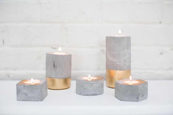 This concrete candleholder with a painted golden base has a natural patina that will add character and warmth to your home. Stunning on your counter or table and will elevate flickering candlelight ad