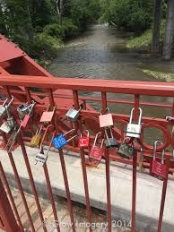 Old Red Bridge in Minor Park / Location: Kansas City, MO / Venue Type: Outdoor / Accommodates: Up to 150 / Venue Style: Bridge / Description: Home to Kansas City's Love Locks tradition and, as such, is an extremely appropriate site for a wedding ceremony.  The placing of love locks is a custom whereby couples affix a padlock to a bridge, fence, or gate so pronouncing their unbreakable and everlasting love. The Old Red Bridge is a pedestrian bridge that sits over the Blue River in South KC