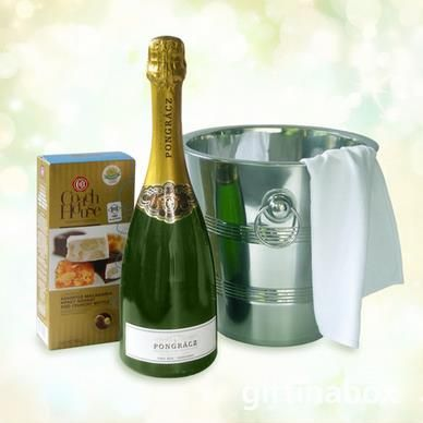 PONGRACZULATIONS Congratulations! - or Pongraczulations with this beautiful gift of top notch sparkling wine beautifully presented in an ice bucket with nougat bon bons.   Bottle of Pongracz Cap Classique sparking wine Box of Coachhouse nougat selection Stainless steel ice bucke