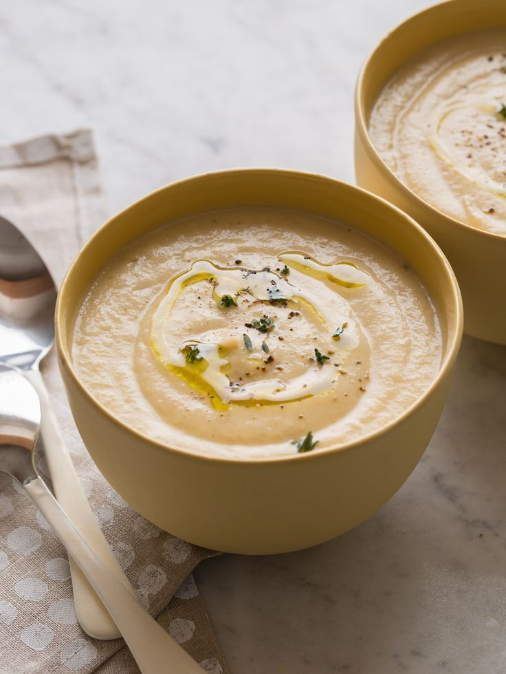 Our easy and delicious Roasted Cauliflower and Parsnip Soup with a lot of depth of flavor from the simple roasted vegetables and hint of cumin and paprika.