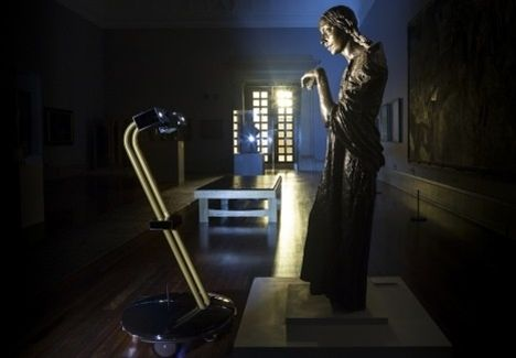 After Dark: a roaming robot taking in Sir Jacob Epstein's The Visitation, 1926 at Tate Britain