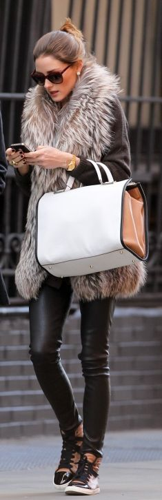 Olivia Palermo's super-cool leather skinny pants, high-top sneakers, and fur vest scream fall outfit perfection!