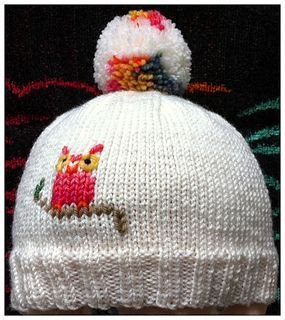 Check out the knit pattern on Ravelry. I like the embroidery on the plain hat. Inspiration