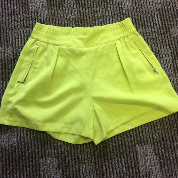 JLO high waist neon green shorts High waisted neon green shorts! Silver zipper pocket detail. They run, a bit big, for a small. So cute and comfortable! Jennifer Lopez Shorts