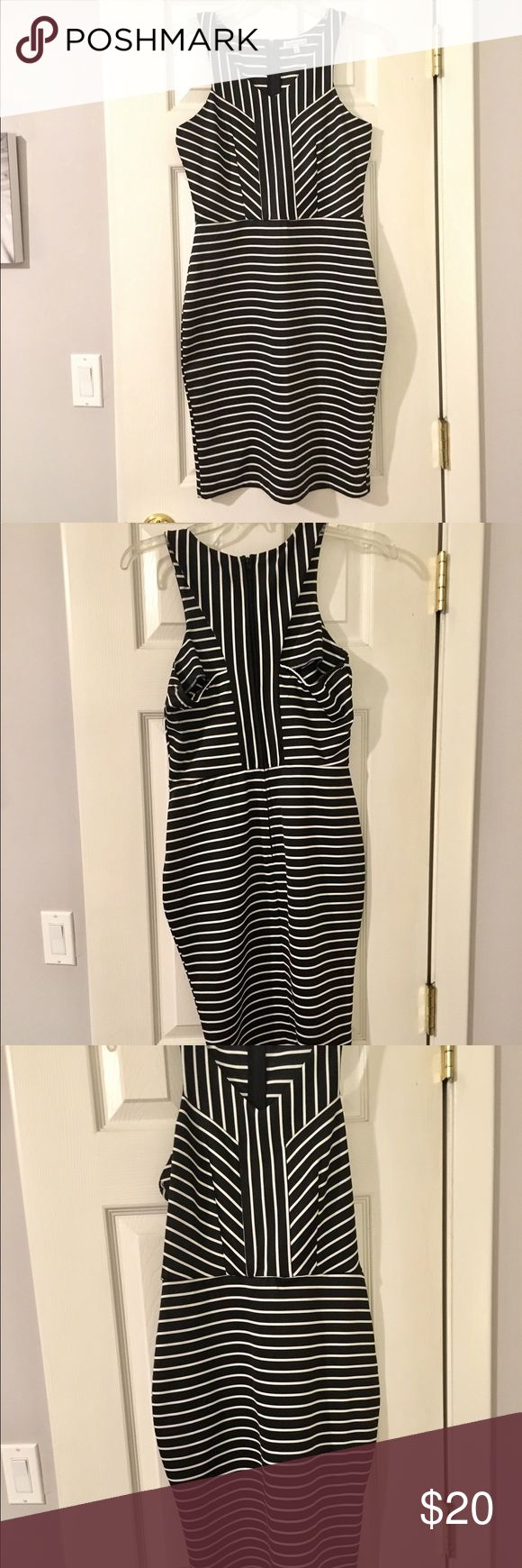 NWOT Charlotte Russe Black/White Striped Dress Here's your next date night look, your next girls   night out style, and your all dressed up just because dress. Stripes never go out of style and this black and white number is a knockout. Fitted style hugs your curves in all the right places and unique racerback style is sure to turn heads. Best of all its never been worn! What a deal! Charlotte Russe Dresses Mini
