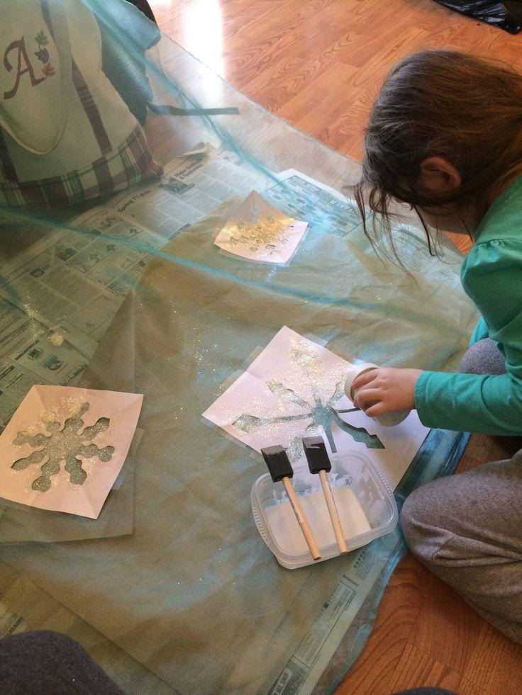 Arianna helping decorate her Elsa cape! #frozen #diy #elsa #cape