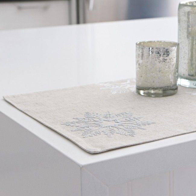 Impress your guests when they sit down to Harman Christmas Snowflake Embroidered Polyester Placemats. A chic, yet subtle natural design features intricate silver & white snowflakes, totally completing your modern contemporary holiday look this Christmas season.