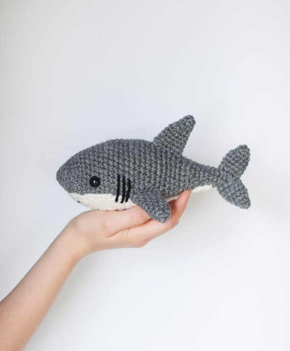 ******PLEASE NOTE: THIS IS A DIGITAL CROCHET PATTERN, NOT THE FINISHED ANIMAL******  Create your own adorable shark in just a couple hours! This easy-to-follow pattern includes one PDF file (4 pages long) with detailed instructions on how to crochet and assemble all the parts to make this shark. Only basic crocheting skills will be needed: chain, single crochet, increasing and decreasing. Difficulty: Easy  Materials needed: Crochet hook size: G/4.00mm Worsted weight yarn: Gray, white, black…